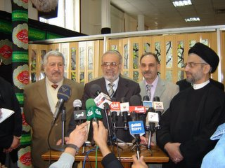 The Shia Islamist, Sunni Islamist and Sunni secular, all looking to be getting along together...thanks to the lamb!